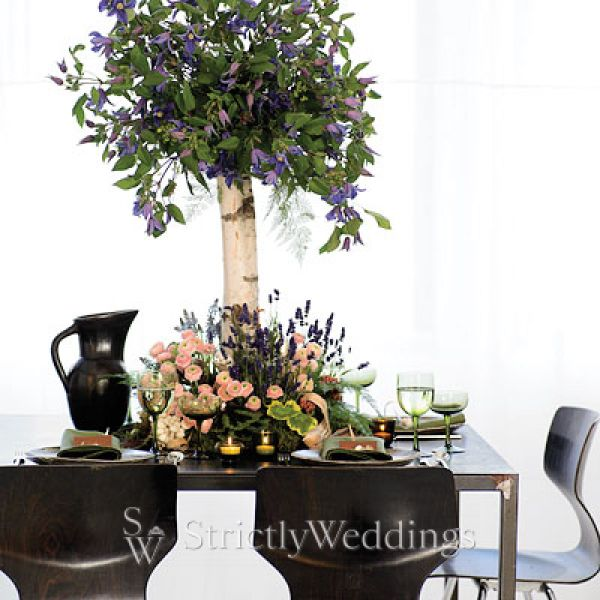 Landscape centerpieces give a whole new dramatic atmosphere to the wedding