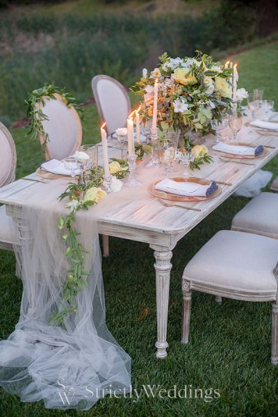 Soft romantic garden wedding ideas strictly weddings for Outdoor wedding table decorations